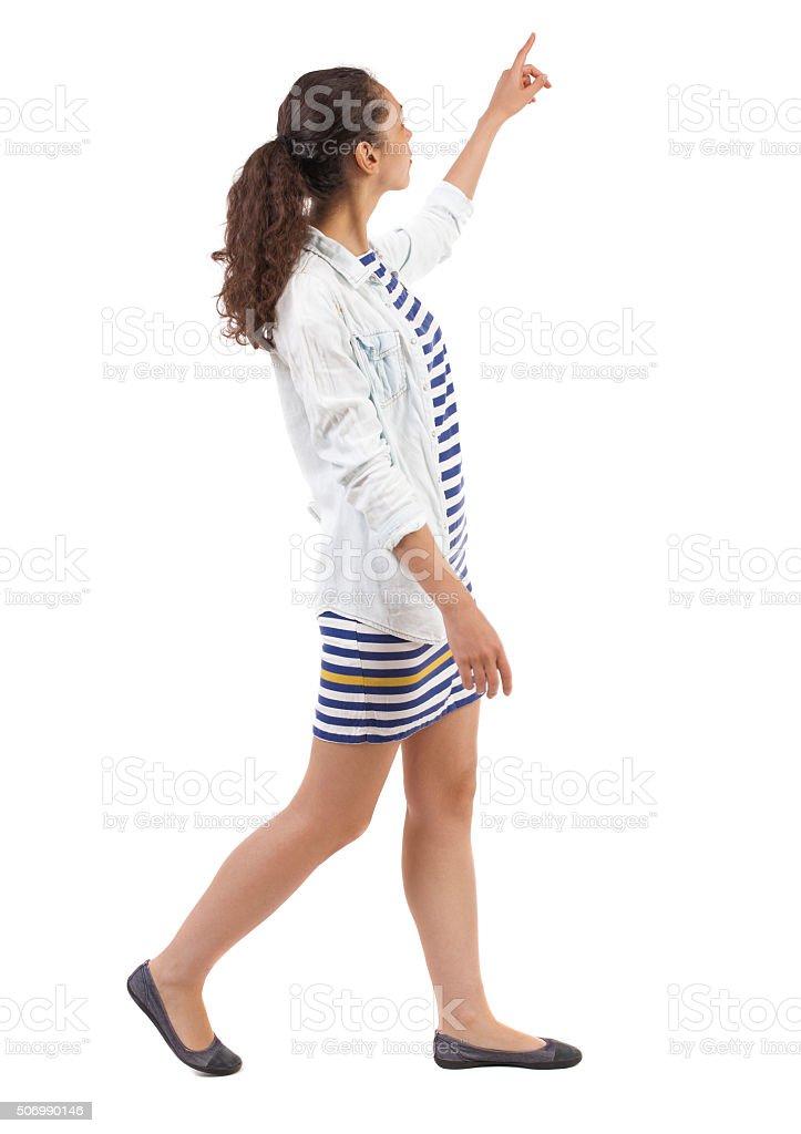 back view of walking  woman. stock photo