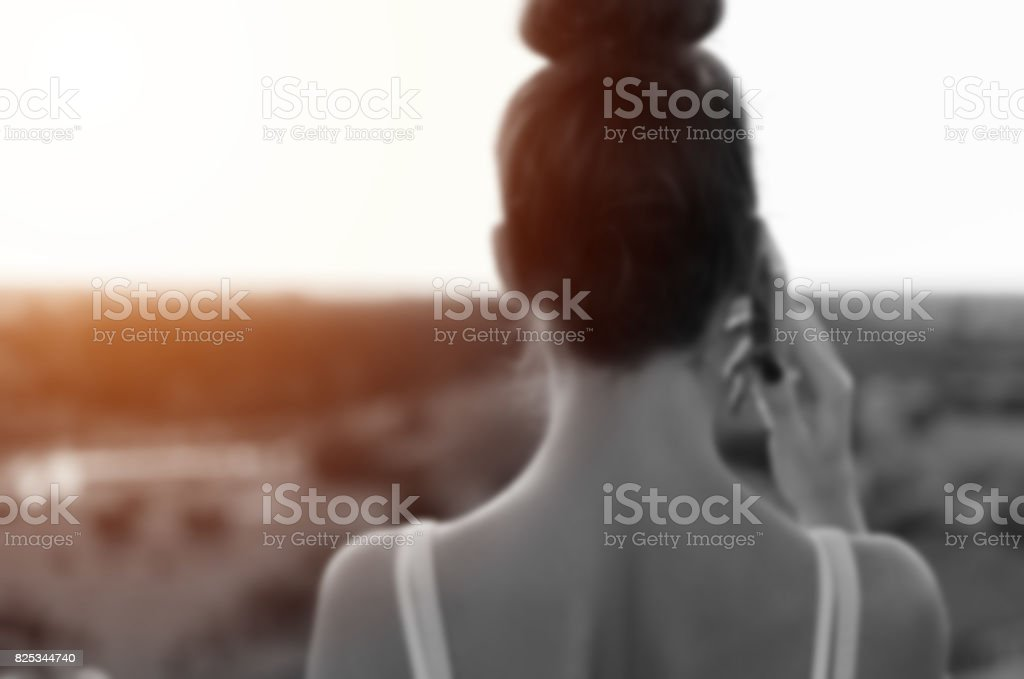 back view of woman back, girl holding mobile phone stock photo