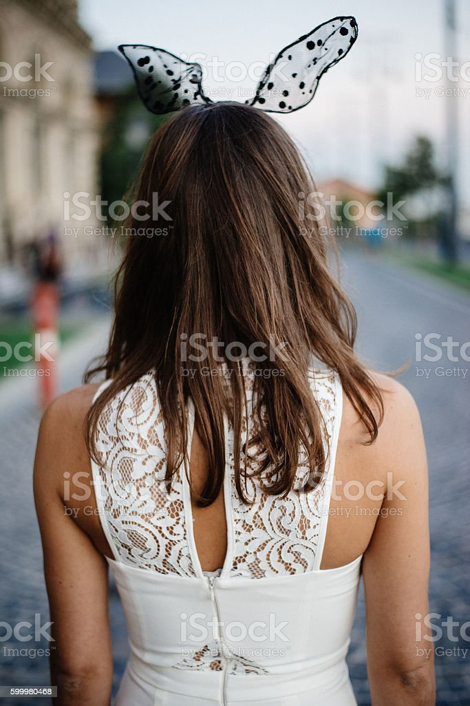 Back view of woman in costume stock photo