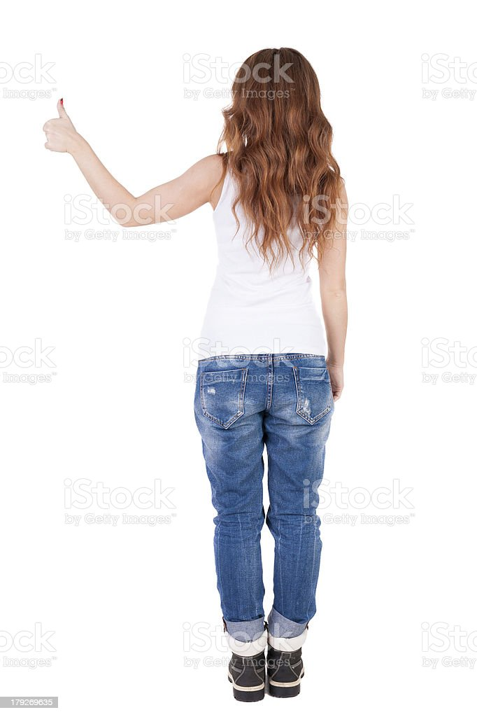 Back view of  woman thumbs up. royalty-free stock photo