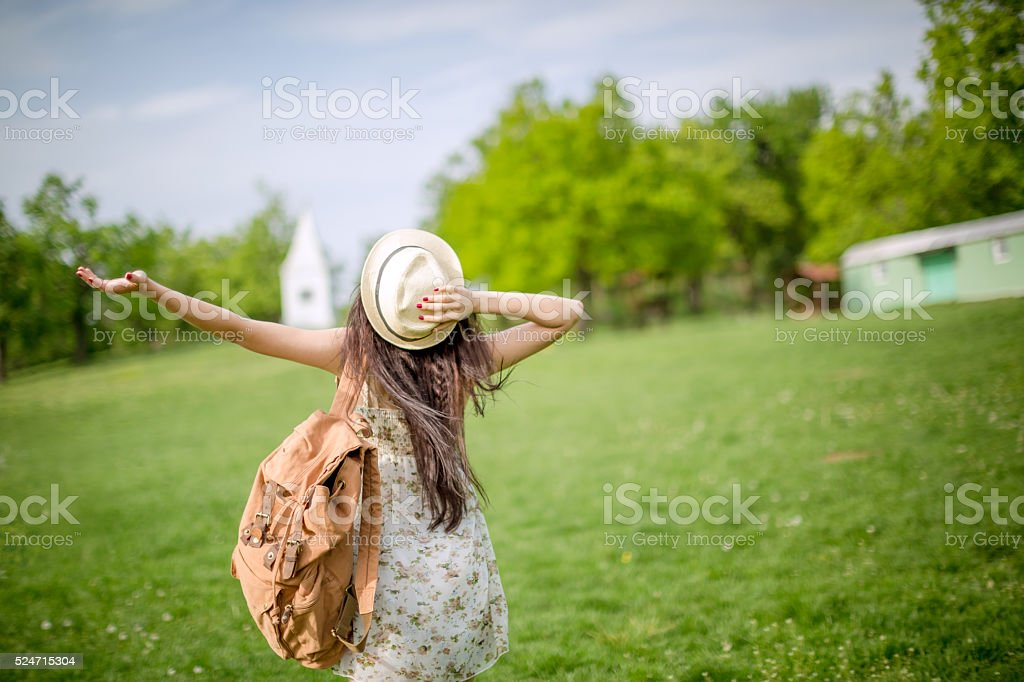 back view of woman with backpack stock photo