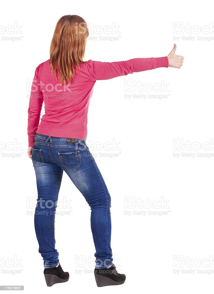 Back view of young beautiful woman  going thumb up. royalty-free stock photo