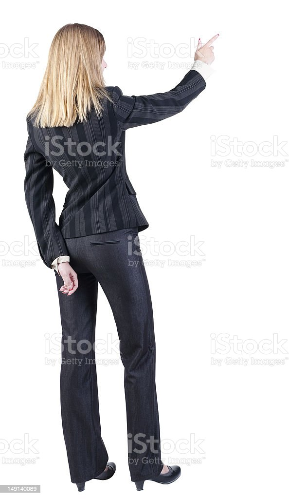 Back view of young blonde business woman pointing at wal royalty-free stock photo