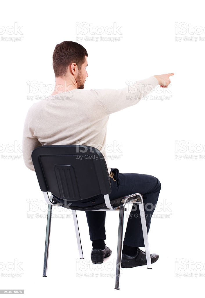 back view of young business man sitting on chair and stock photo
