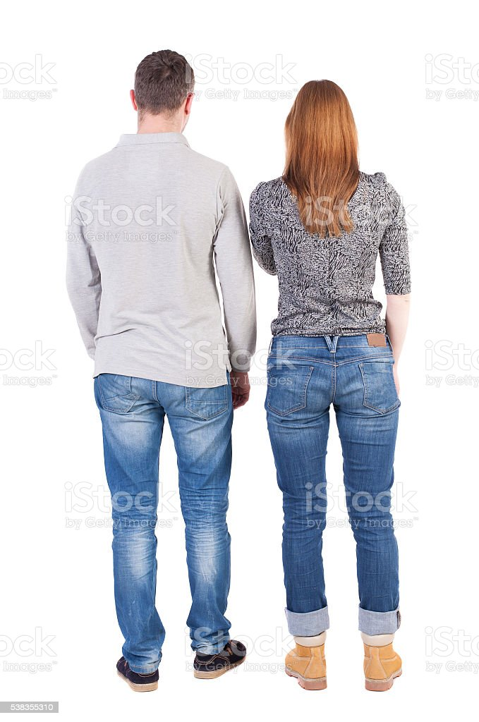 Back view of young embracing couple hug and look stock photo