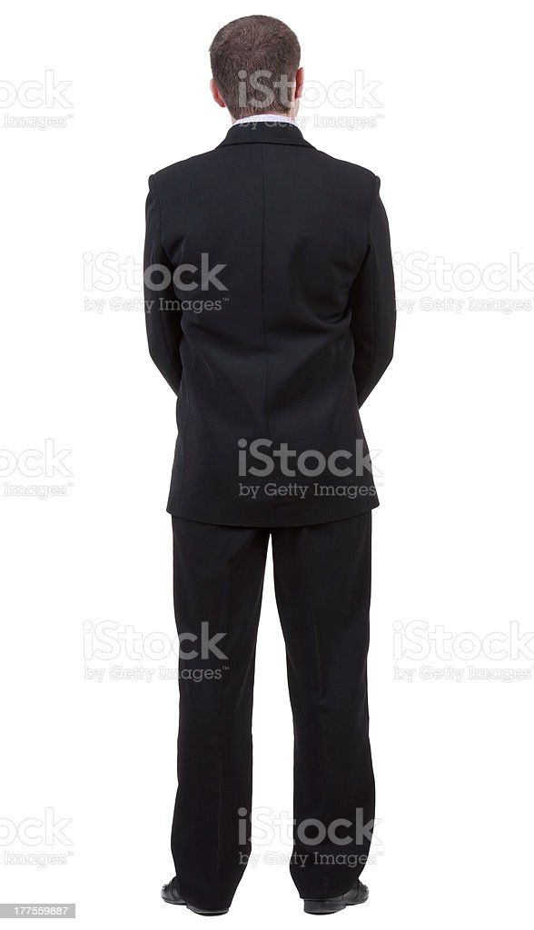 back view of young guy in black suit  watching. royalty-free stock photo