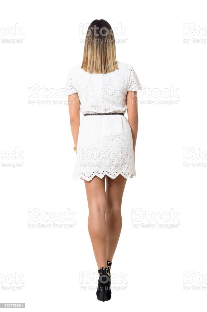 Back view of young sexy woman in lace dress walking away. stock photo