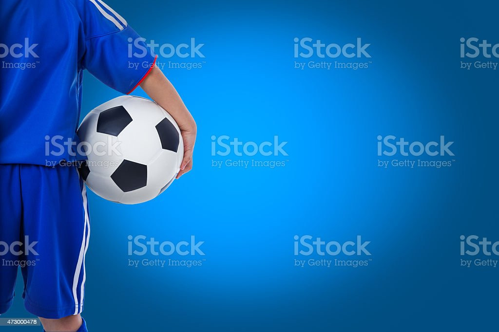 Back view of youth soccer player in blue uniform and little kid...