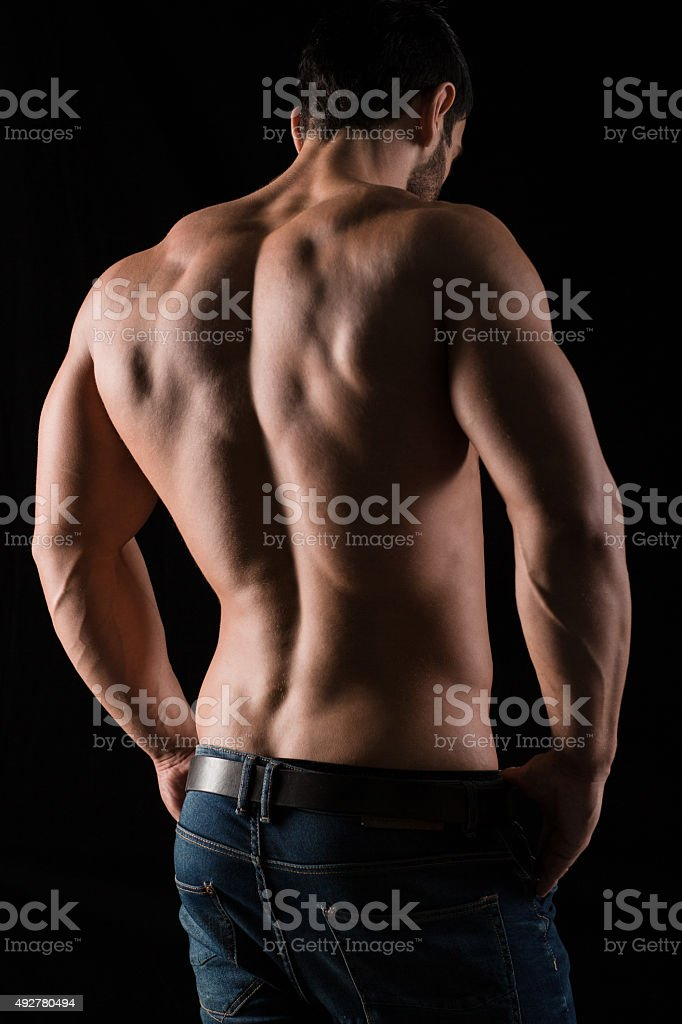 Back view portrait of a man with muscular body stock photo