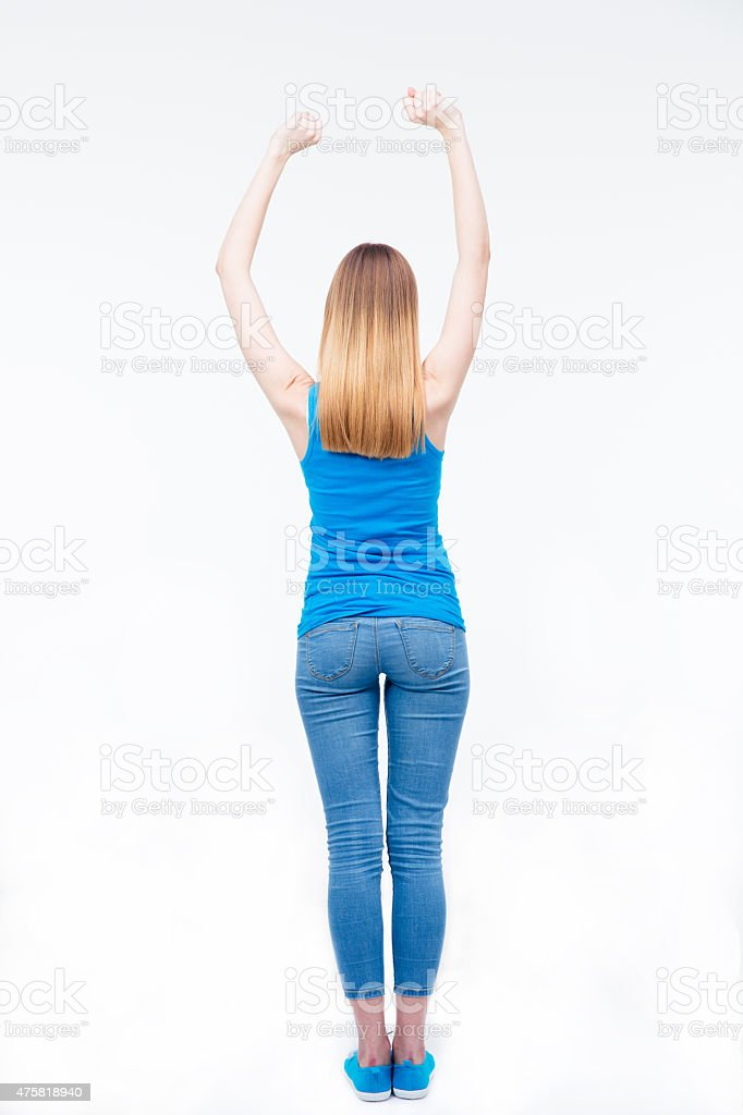 Back view portrait of a young casual woman stock photo