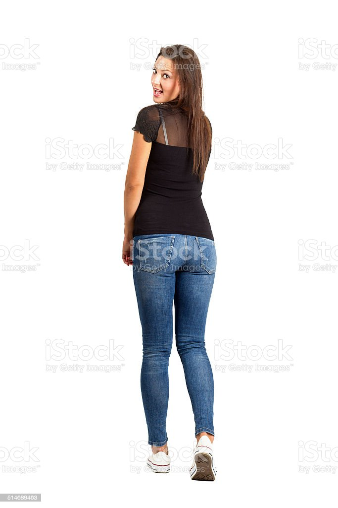 Back view posing brunette beauty in casual clothes. stock photo