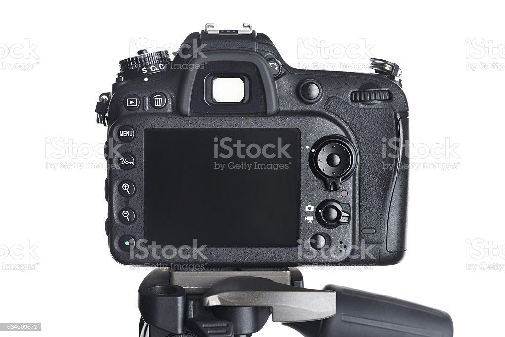 Back view SLR camera on tripod isolated white stock photo