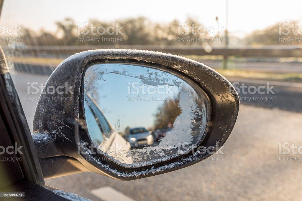 Back view through frozen car wing mirror on motorway stock photo