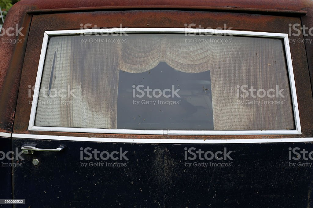 Back Window of an abandoned hearse stock photo