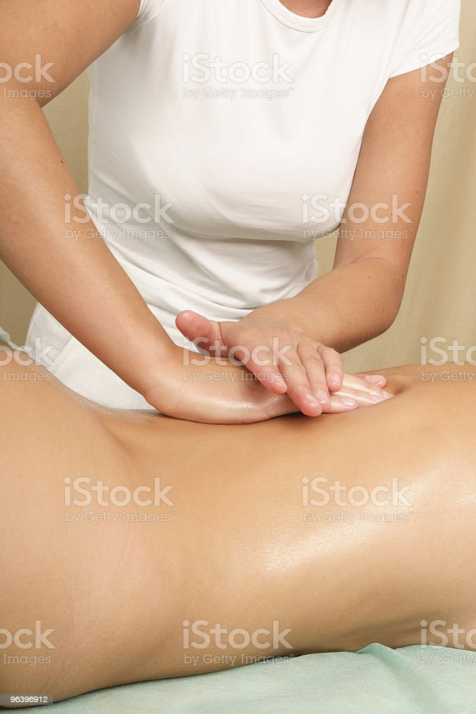 Back woman massage - vertical royalty-free stock photo