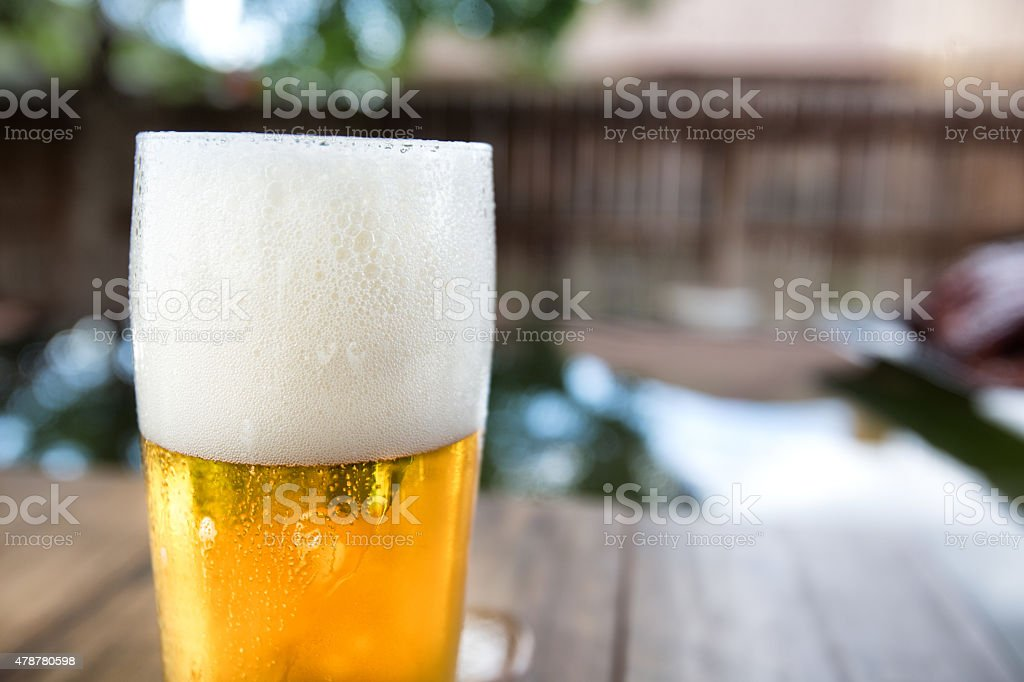 Back Yard Beer in Glass on Patio stock photo