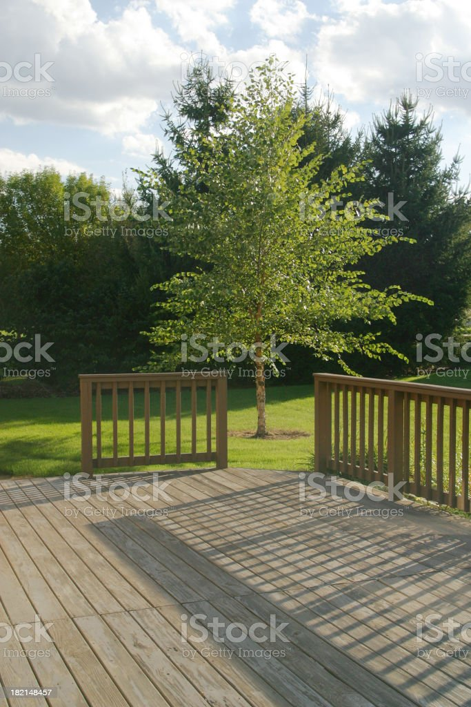 Back Yard Wood Deck With Evening Shadows 2 royalty-free stock photo