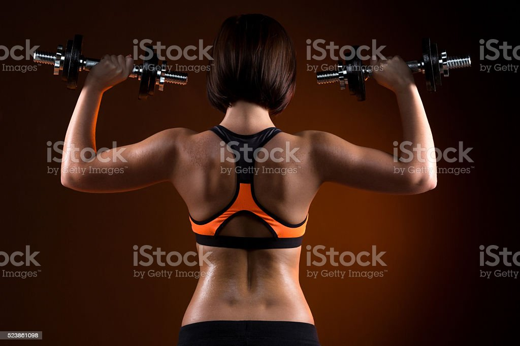 back young fitness girls with dumbbells stock photo