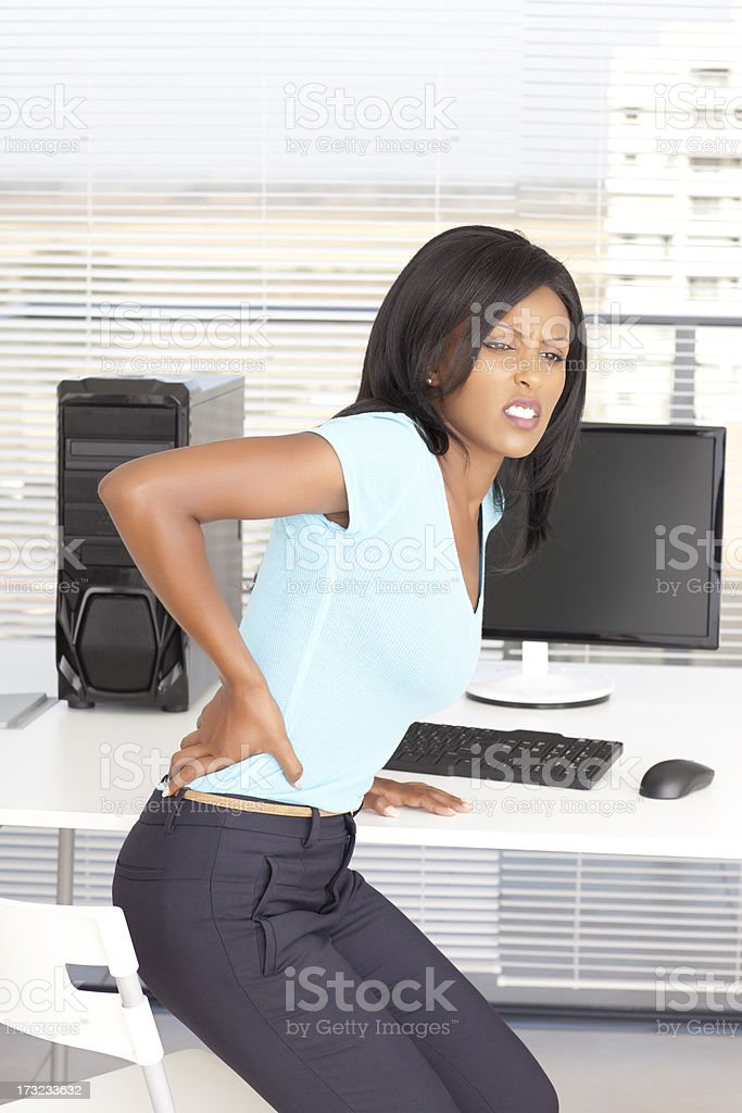 Backaches at work. stock photo