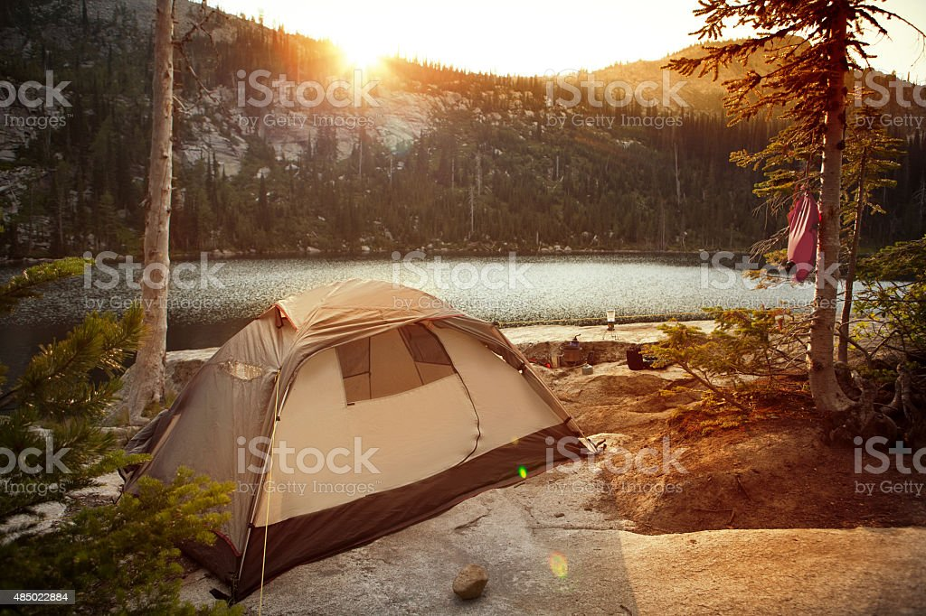 Backcountry camping along a beautiful alpine lake. stock photo