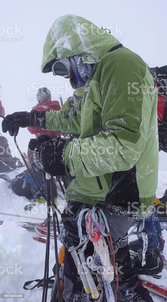 backcountry skier in a snow storm on the sumit stock photo