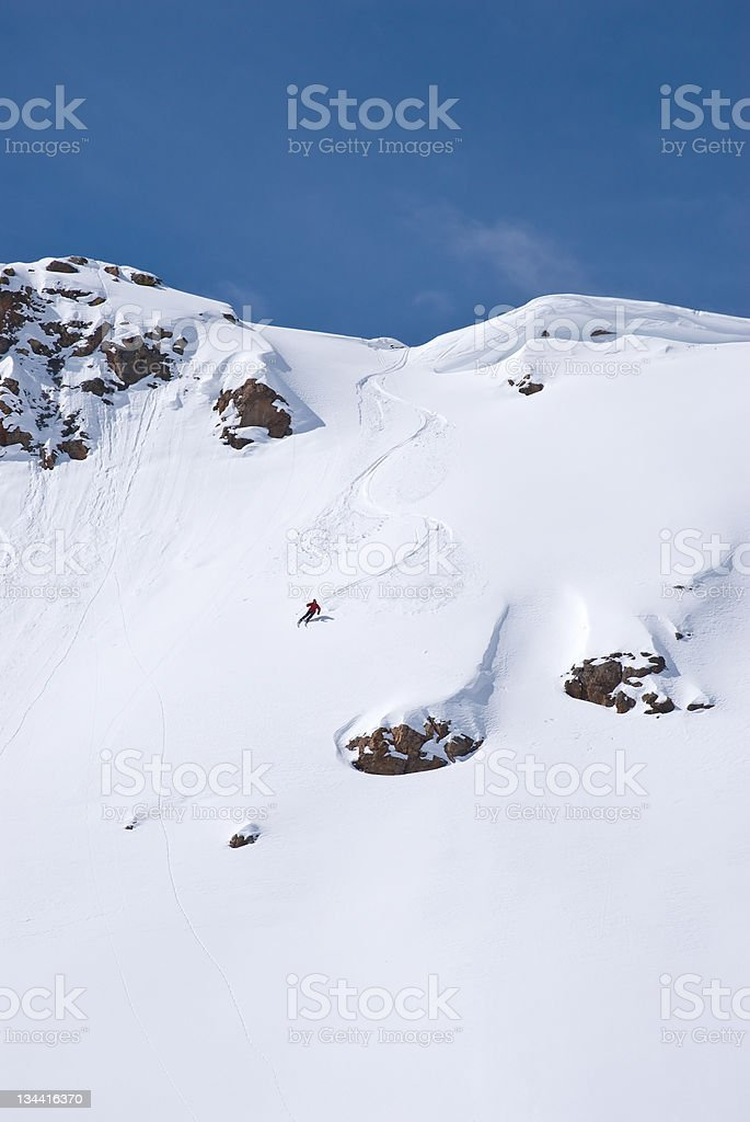 Backcountry Skier Skis Steep Mountain Terrain royalty-free stock photo