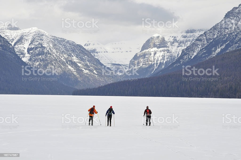 Backcountry Skiers on Bowman Lake royalty-free stock photo
