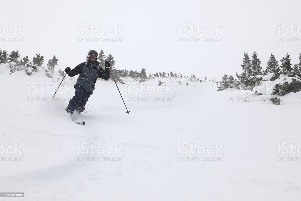 Backcountry telemark skier in Colorado powder copy space royalty-free stock photo