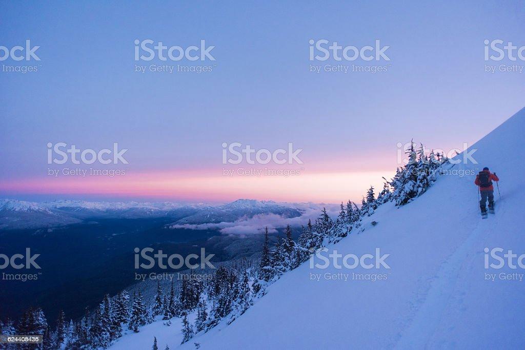 Backcountry touring at sunrise stock photo