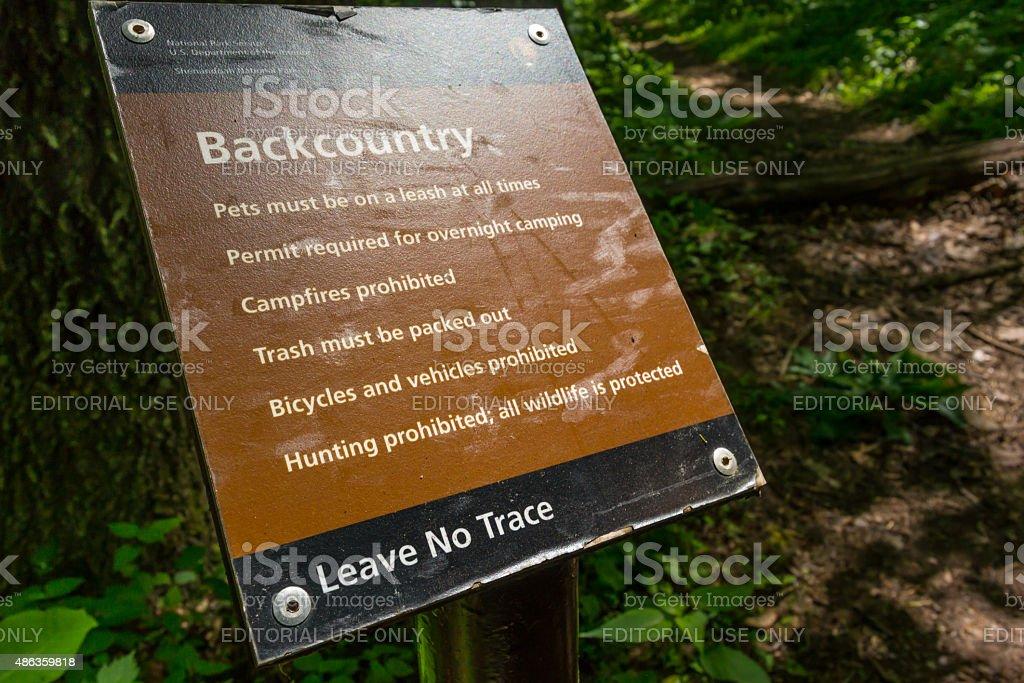 Backcountry Warning Sign stock photo