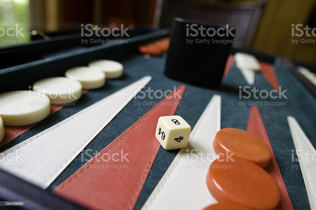 Backgammon Board and Die Up Close royalty-free stock photo