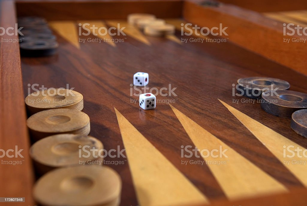 Backgammon board in polished wood with die centrally placed stock photo