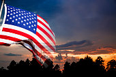 Background:  American flag with sunset background.