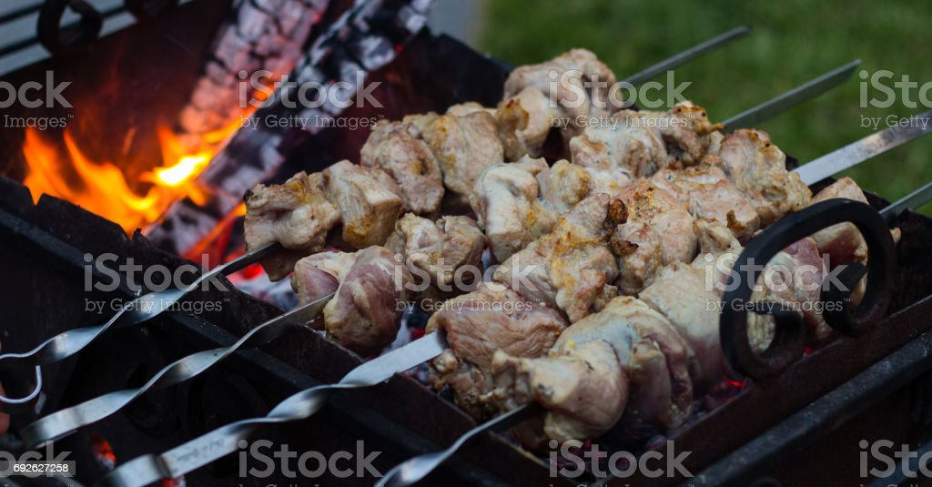 Background appetizing meat on skewers stock photo