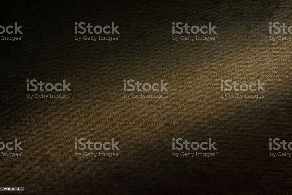 Background beige fabric highlighted by a spotlight. stock photo
