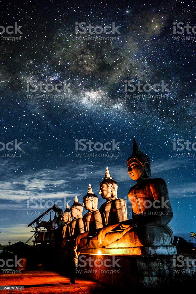 Background blur Milky Way and statues in the night stock photo