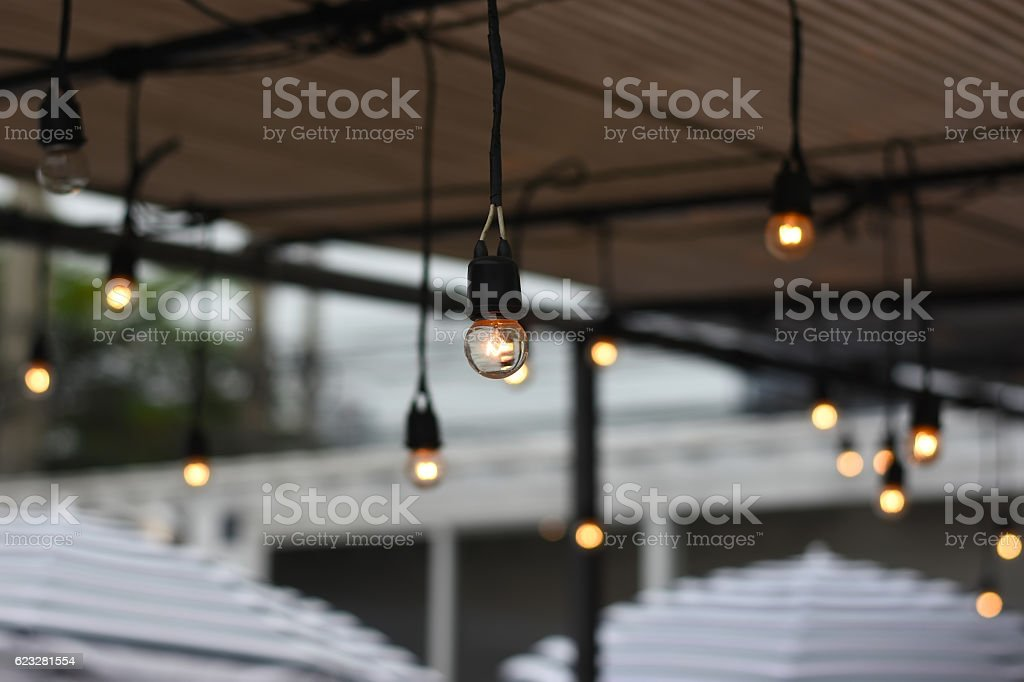 Background Blurred photo : Outdoor string lights. stock photo