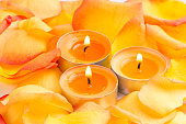 background - burning candles and rose petals