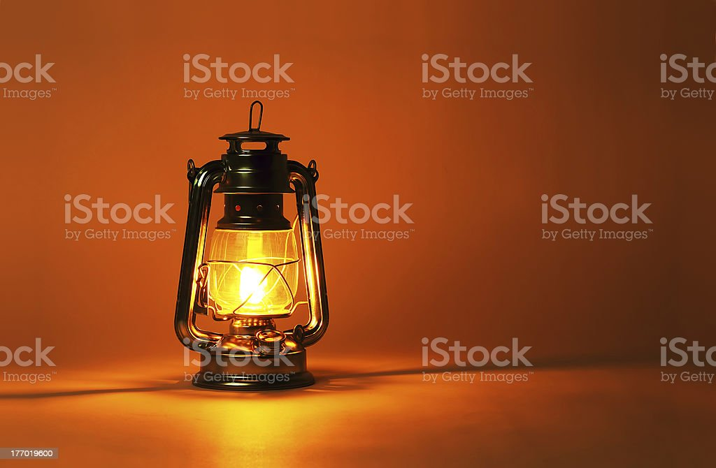 Background burning kerosene lamp stock photo