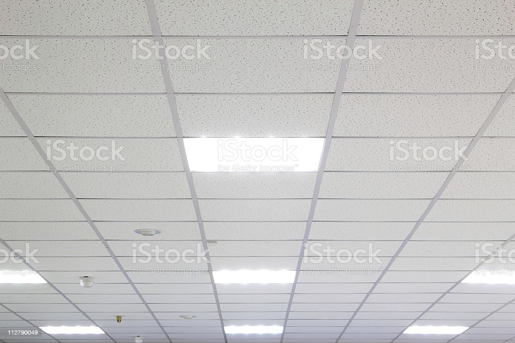 Background ceiling tiles with lights stock photo