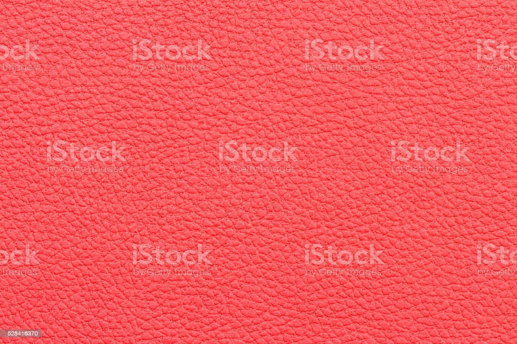 background: close-up of red leather fabric stock photo