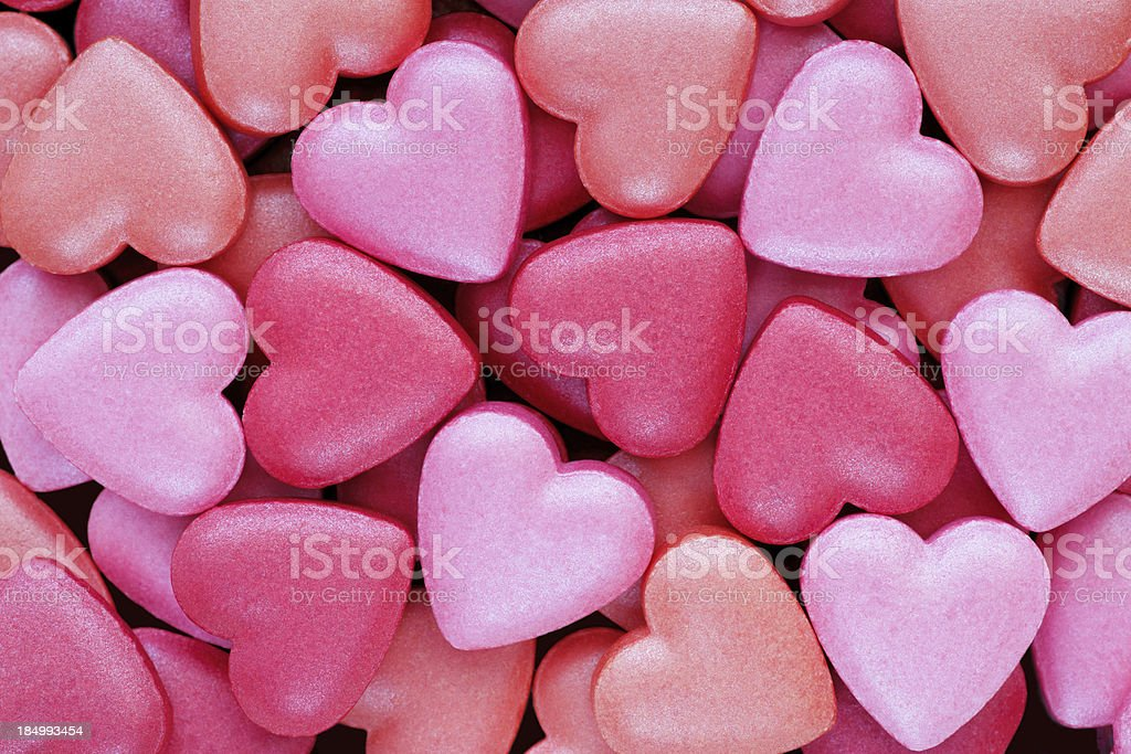 Background: Colorful, heart shaped candies suitable for Valentine greetings stock photo
