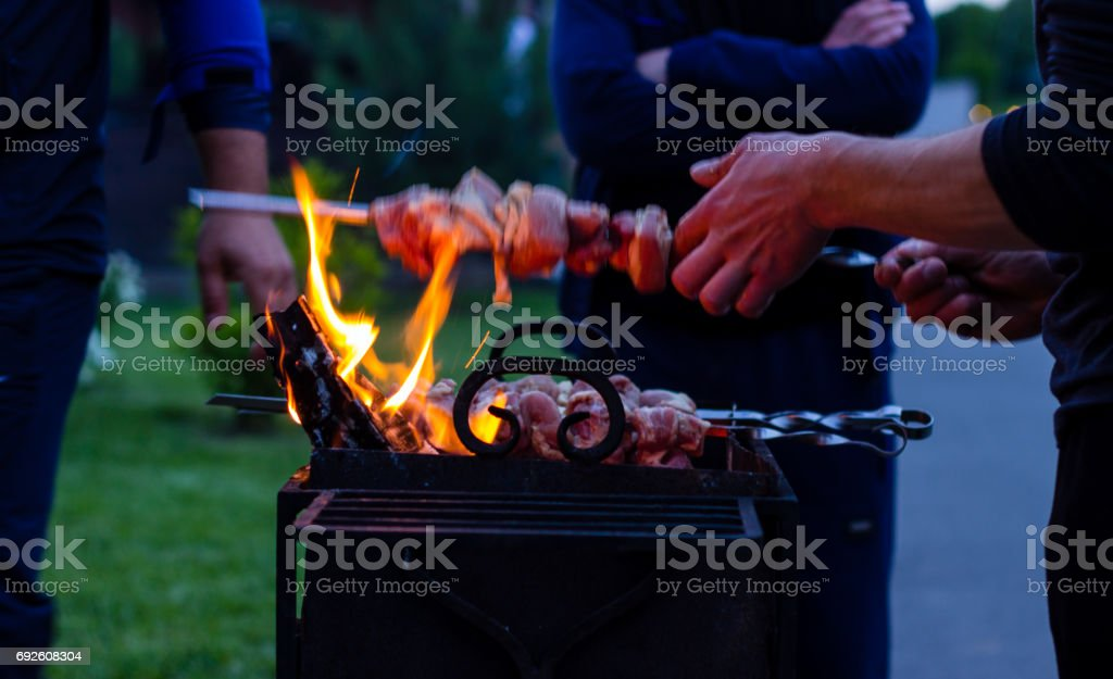 Background cooking shish kebab in the evening stock photo