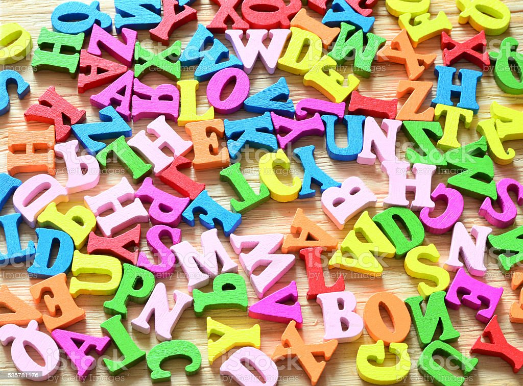 Background created from multi-colored wooden letters stock photo