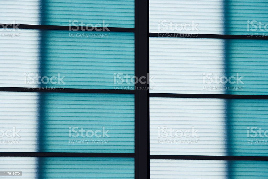 background cyan frosted glass of geometric window royalty-free stock photo