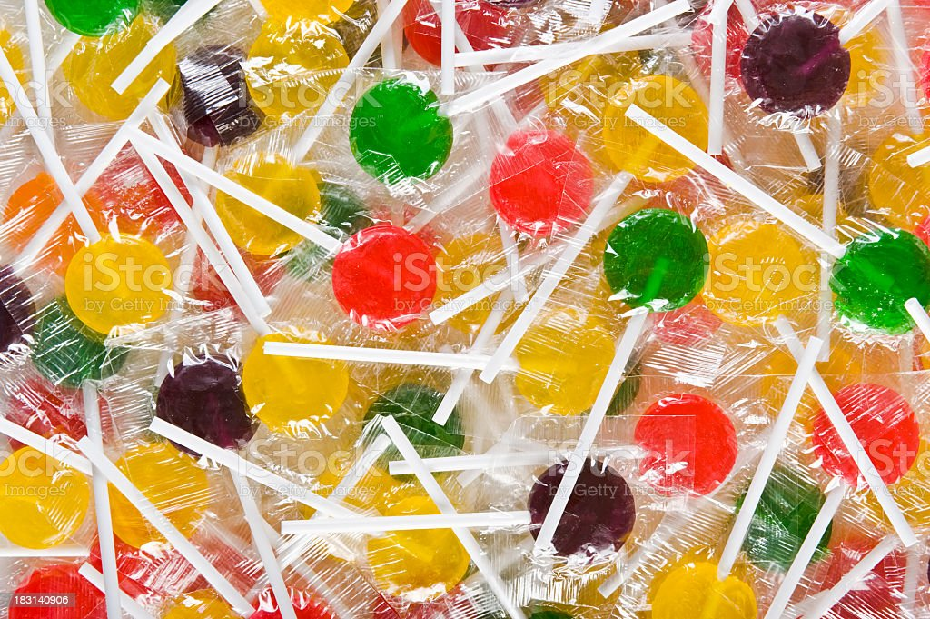 Background filled with colorful lollipops stock photo