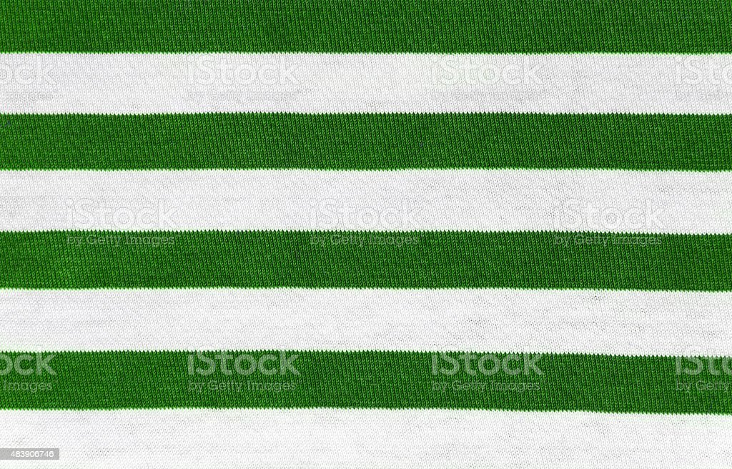 Background from a striped green white fabric stock photo