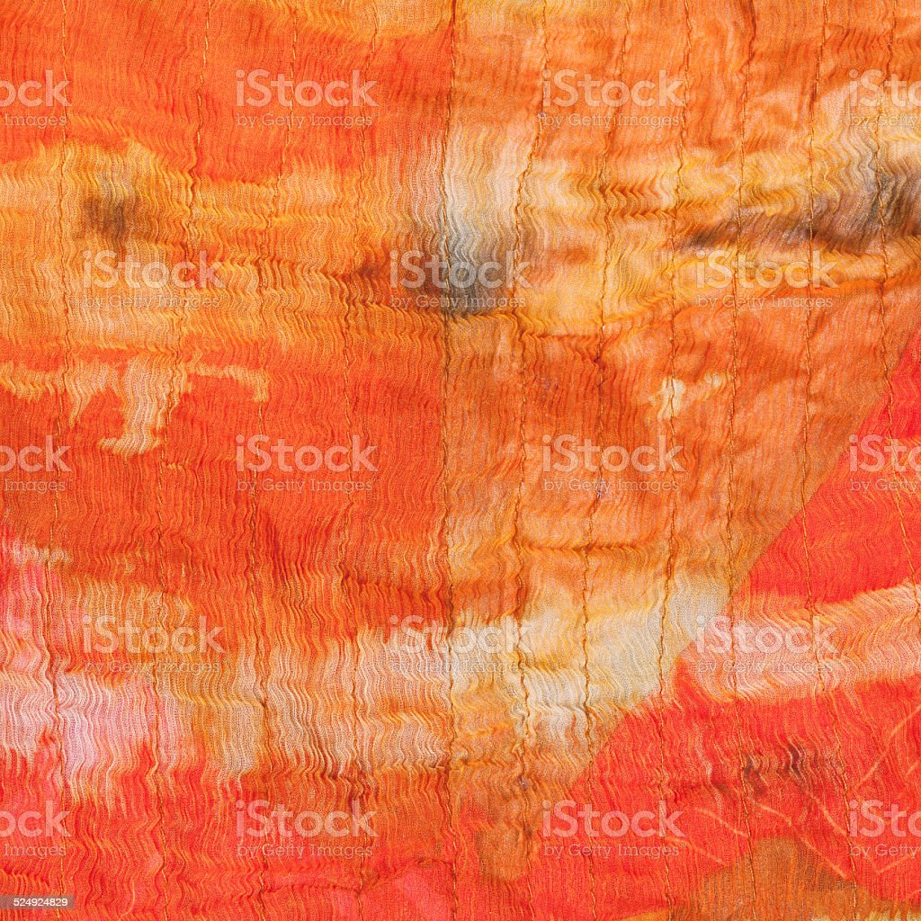 background from abstract painted orange silk batik stock photo