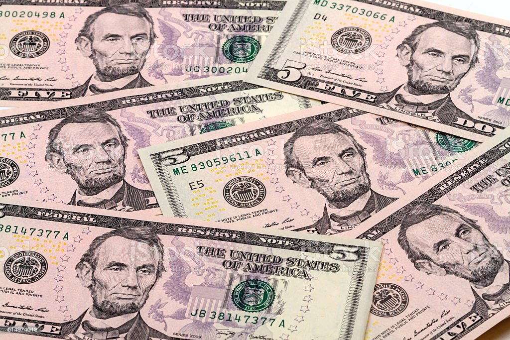Background from banknotes five dollar stock photo