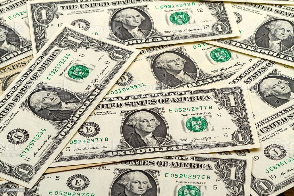 Background from banknotes one dollar stock photo